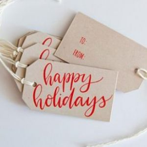 Brown gift card with red writing