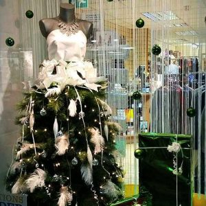 Female mannequin christmas shop display